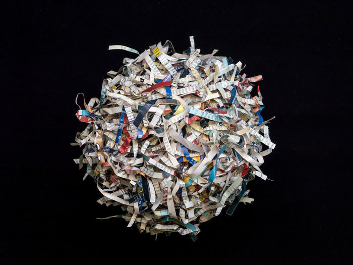 Shredded paper cuttings formed into sphere on black background Junk Mess Sphere Text Writing Ball Black Background Confusion Creativity Cut Out Cuttings Environment Garbage Paper Recycling Shredded Stack Studio Shot Waste Wastepaper Basket