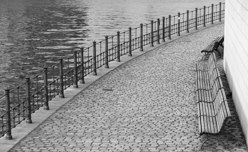 Black And White Architecture River Spree Government District Bench Seating Diagonal Water Railing Sea Nature Outdoors In A Row Day Footpath No People High Angle View The Way Forward Direction Tranquility Built Structure Street Pier Empty Absence