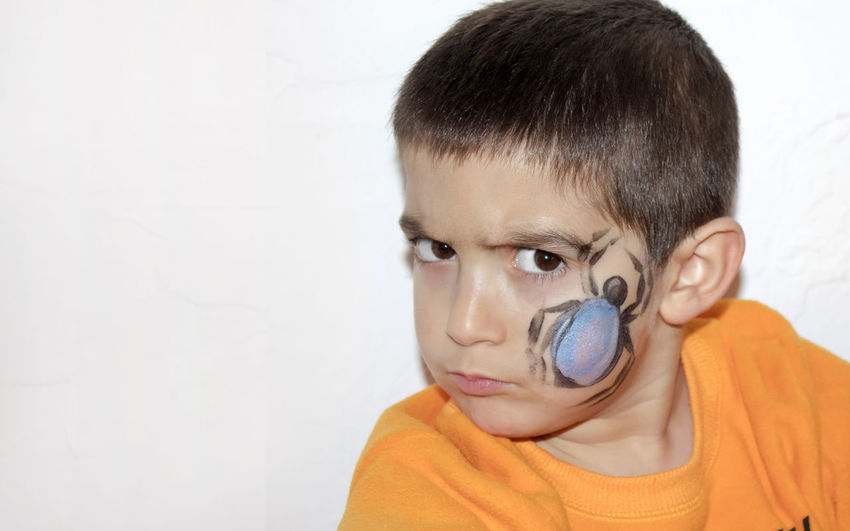 Angry boy with face painted with a spider Angry Art Carnaval Childhood Face Paint Face Painting Fiesta Human Body Part Make-up Makeup Party Time Silly Faces  Spider Spider Art