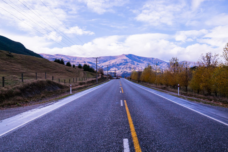 Asphalt Beauty In Nature Cloud Cloud - Sky Cloudy Country Road Countryside Day Diminishing Perspective Empty Empty Road Landscape Long Mountain Mountain Range Nature Non-urban Scene Road Road Marking Scenics Sky The Way Forward Tranquil Scene Tranquility Vanishing Point