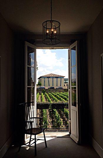 Farm seen through open door at home