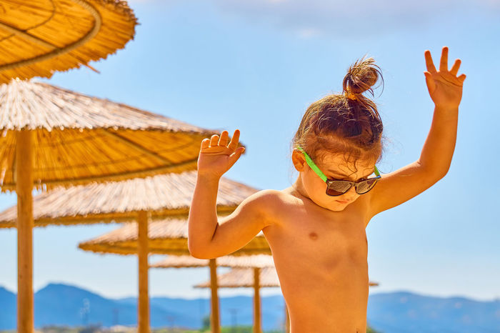 Suuny day at Valti Beach, Sithonia, Halkidiki, Greece Beach Cheerful Child Childhood Dance Day Happiness Leaf One Person Palm People Portrait Sky Sunglasses Umbrellas Vacations Girl female Kid Live For The Story This Is My Skin