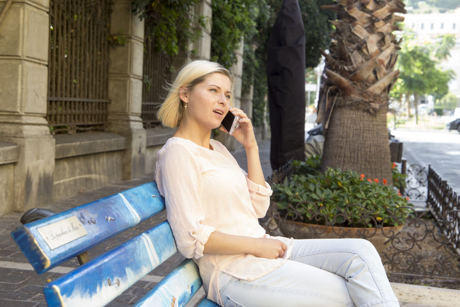 Alone Bench Blonde Calling Free Time Happy Life Real Sitting Woman Conversation Day Female Girl Mobile Normal Outdoors Outside People Phone Pretty Real People Relaxation Talking Young Adult