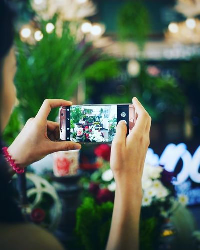 Mobile Conversations Photography Themes Smart Phone Photographing Portable Information Device Photo Messaging Wireless Technology Communication Technology Device Screen Mobile Phone Women Defocused Holding Outdoors Selfie Adults Only Nature Adult Journey Only Women