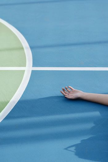 Cropped Hand Of Woman On Court