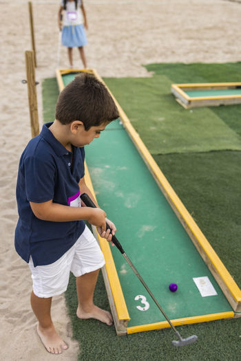 Children playing mini golf
