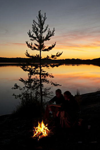A Campfire Beauty In Nature Dreaming Finnish Wilderness Lake Lonely Lake Love Nature Night Outdoors Reflection Sky Summer Nigiht In Finland Sunset Togetherness Togetherness In Loneliness Two People Water