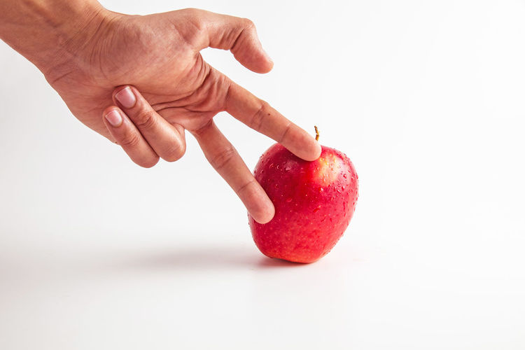 Human Hand Healthy Eating Hand White Background Human Body Part Food And Drink Food Studio Shot Fruit Wellbeing Apple - Fruit Red Indoors  Freshness One Person Holding Single Object Close-up Copy Space Finger Snack Human Limb Healthy Lifestyle
