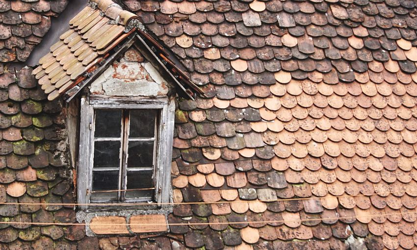 A window Architecture Built Structure Building Exterior Building Window Day No People House Outdoors Wood - Material Pattern Roof Residential District Roof Tile Old