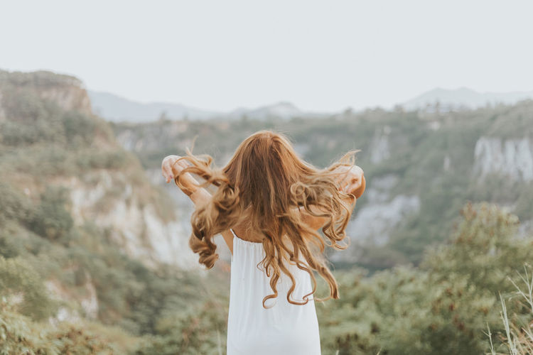 Midsection of woman standing on mountain