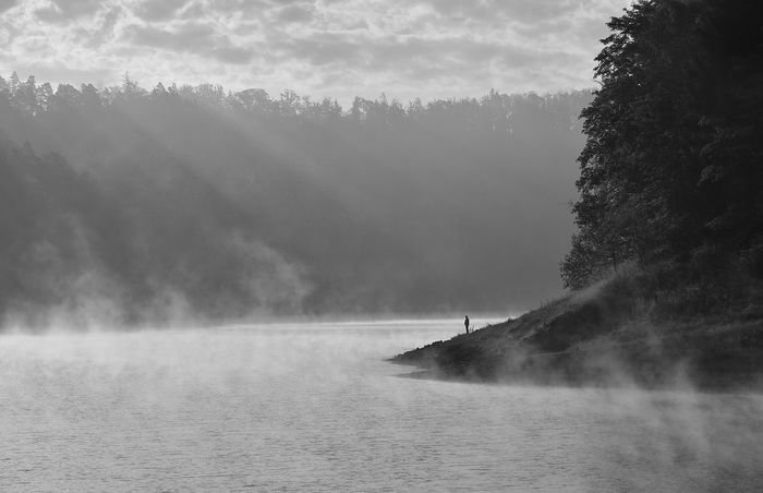 Scenic view of river during foggy weather