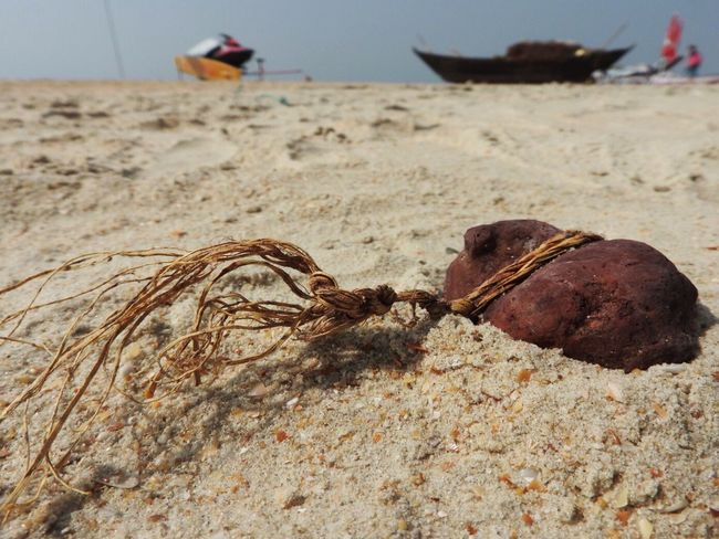 On the beach in Goa Travel Destinations Travel Beach Focus On Foreground Sand Handmade Plant Material Twine, Cord, Yarn, Thread, Strand, String Stone Fishing Boat