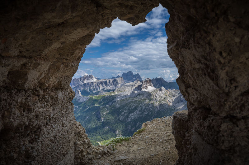 Dolomites Dolomites, Italy Framed Monte Pelmo Beauty In Nature Cloud - Sky Environment Formation Italy Lagazuoi Landscape Mountain Mountain Peak Mountain Range Nature No People Outdoors Rock Rock - Object Rock Formation Scenics - Nature Tranquil Scene Tranquility Tunnel