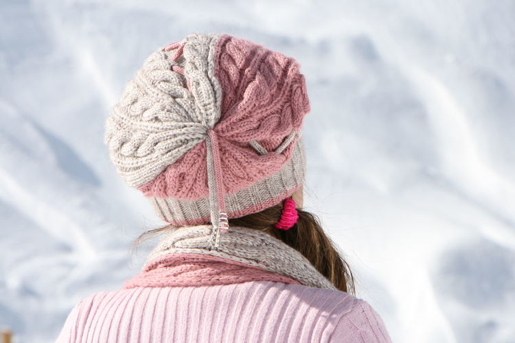 Rear view of woman wearing hat during winter