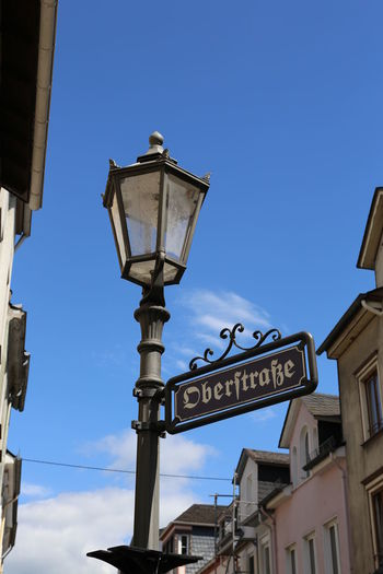 Oberstraße Low Angle View Sky Architecture Built Structure Building Exterior Text Lighting Equipment Blue Street Communication Street Light Sign Nature Clear Sky Western Script Day No People Building Information Information Sign Outdoors Electric Lamp