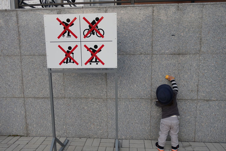 Kid Boys Will Be Boys Sign Communication Real People Rear View Day Text Men Red Standing People Lifestyles Outdoors Transportation Casual Clothing Guidance Representation Human Representation Footpath Leisure Activity