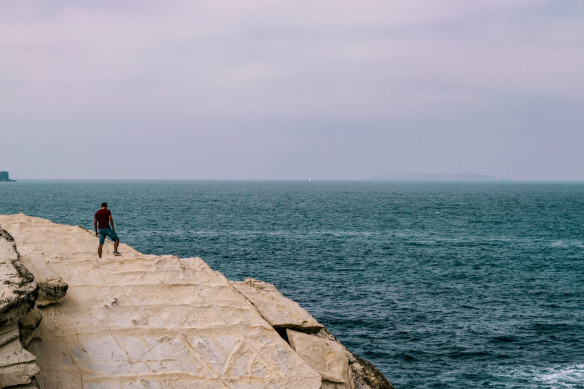 Beauty In Nature Horizon Horizon Over Water Leisure Activity Lifestyles Looking At View Men Nature One Person Outdoors Real People Rock Rock - Object Scenics - Nature Sea Sky Solid Standing Tranquil Scene Water Be Brave