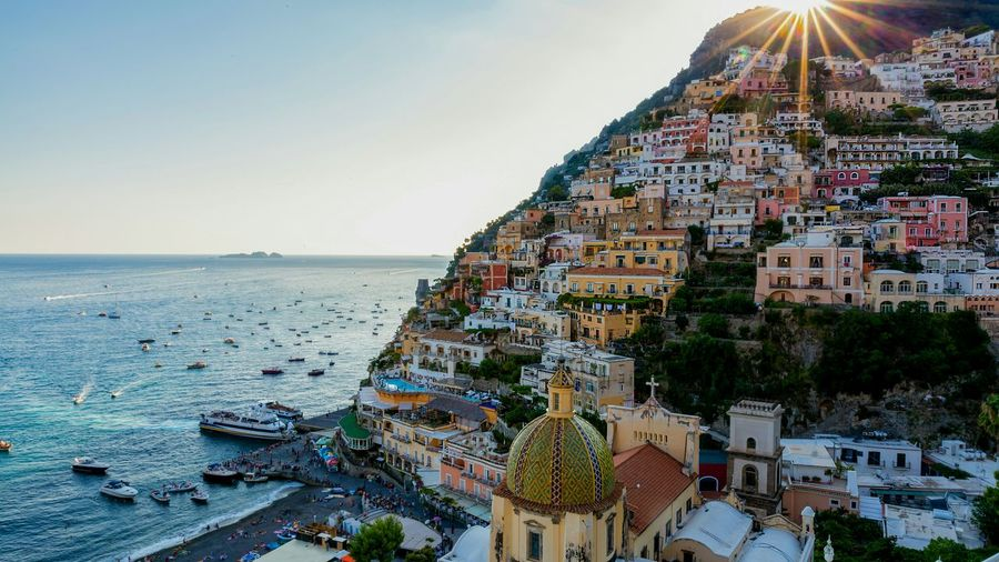 Summer in Positano Sunburst Houses Seaside Village EyeEm Selects EyeEm Gallery Sunny Holidays Travel Destination Bella Italia Amalfi Coast Costiera Amalfitana Water Sea Beach Clear Sky Multi Colored City Sky Architecture Horizon Over Water Sunset Seascape Coast Idyllic Tranquility Urban Scene Colorful