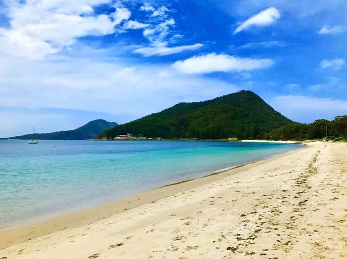 Scenic view of shoal bay against sky