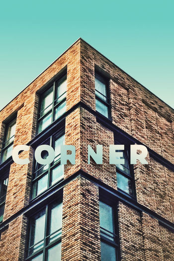 Corner. P114 Onephotoaday 365project Amsterdam Corner Edge Architecture Appartment Bricks Typography Pstouch IPhoneography Lookingup Symmetrical Getting Creative