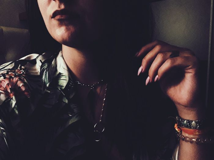 Midsection Of Young Woman Wearing Jewelry