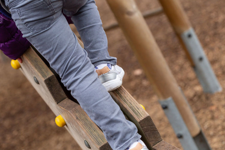 Low Section Of Child Playing At Playground