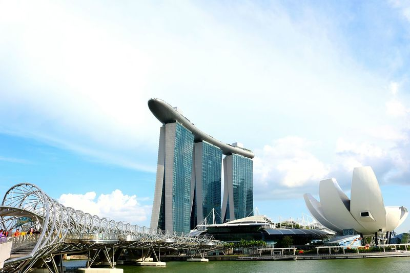 View of marina bay sands and artscience museum against cloudy sky