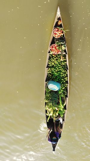 sell fruits and vegetables on the river Market Seller River Lokbaintan Lokbaintan Floating Market Local Floatmarket Floating In Water Traditional Market Multi Colored Water Close-up Boat Floating On Water Floating For Sale