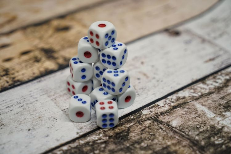 Arts Culture And Entertainment Close-up Dice Focus On Foreground Gambling Game Of Chance Group Of Objects High Angle View Indoors  Leisure Activity Leisure Games Luck No People Number Opportunity Relaxation Selective Focus Spotted Still Life Table Wood - Material