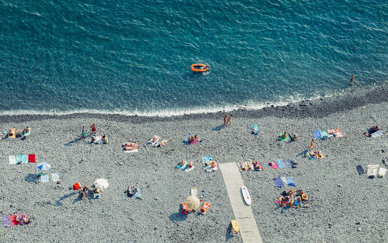 """Top view of the rocky """"Garajau"""" beach in Madeira island, Portugal. Garajau Madeira Island Madeira Island Portugal Relaxing Rocky Beach Tourist Attraction  Travel Travel Photography Beach Crowd Group Of People High Angle View Large Group Of People Leisure Leisure Activity Lifestyles Peaceful Sea Stone Beach Summer Tourist Destination Travel Destinations Vacations"""