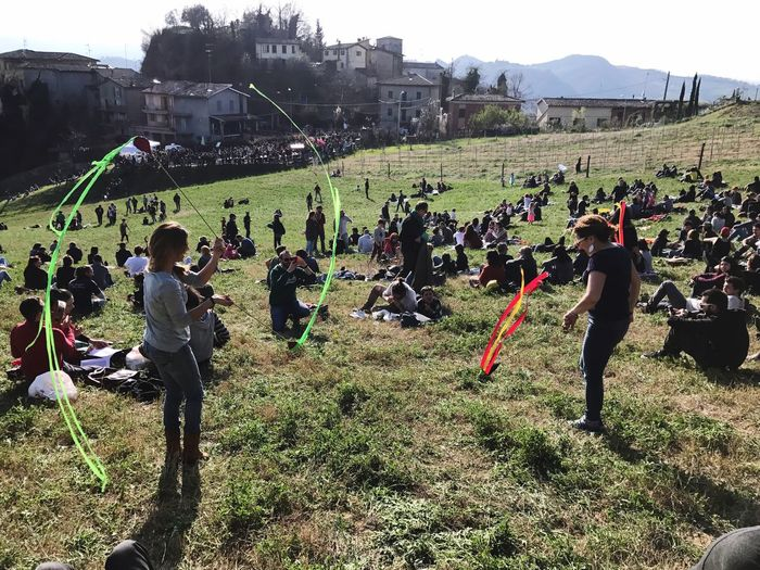 Saracca Bologna Large Group Of People Real People Building Exterior Grass Built Structure Architecture Field Women Men Growth Arts Culture And Entertainment Tree Day Outdoors Playing Nature Teamwork Army Annual Event