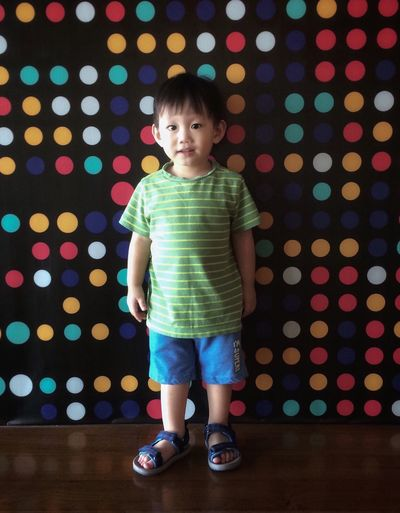 2018 In One Photograph Happy Childhood Child Offspring One Person Indoors  Illuminated Moments Of Happiness Looking At Camera Full Length Portrait Standing Innocence Cute Front View Emotion Casual Clothing Polka Dot Hairstyle