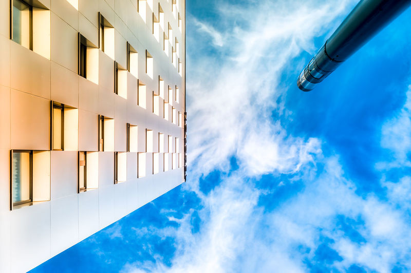 Architecture Blue Building Exterior Built Structure City Close-up Cloud - Sky Day Low Angle View Modern Street Light No People Outdoors Pillar Shapes And Forms Sky