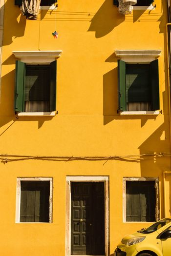 Low angle view of yellow building on sunny day