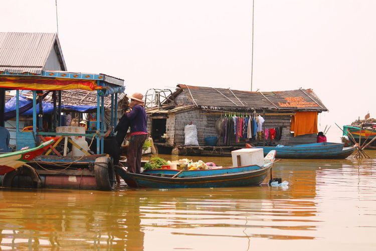 Tonle Sap Lake Floating Village Cambodia Transportation Travel Nautical Vessel Reflection Sky Water Harbor Travel Destinations Day Outdoors Built Structure Architecture Purist In Photography Purist No Edit No Filter Social Issues Cambodian Village Cambodia Life Struggle Poverty Real People Vacations