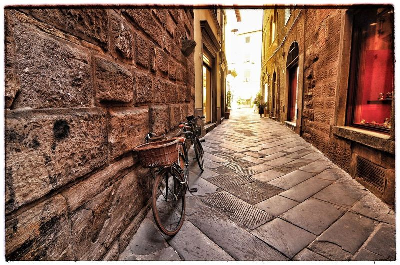 Bikes Lucca Italy Building Exterior Transfer Print The Way Forward Built Structure Architecture Auto Post Production Filter Day Sunlight Building City Footpath Paving Stone Alley