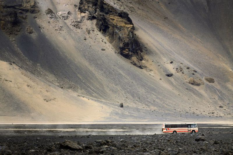 Bus passing through Desert Landscape , interior of Iceland Iceland_collection Transportation Surrealistic Landscape Barren Outdoors Dusty Dusty Road No People Traveling Travel Travel Photography Feel The Journey On The Way Connected By Travel