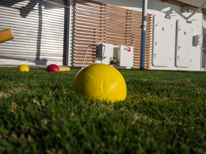 Croquet on the artificial lawn Artificial Grass Ball Close-up Croquet Grass Grassy Lawn Sport Yellow Ball