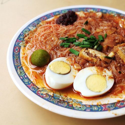 Close Up Of Noodles With Sauce, Meat And Hard Boiled Egg