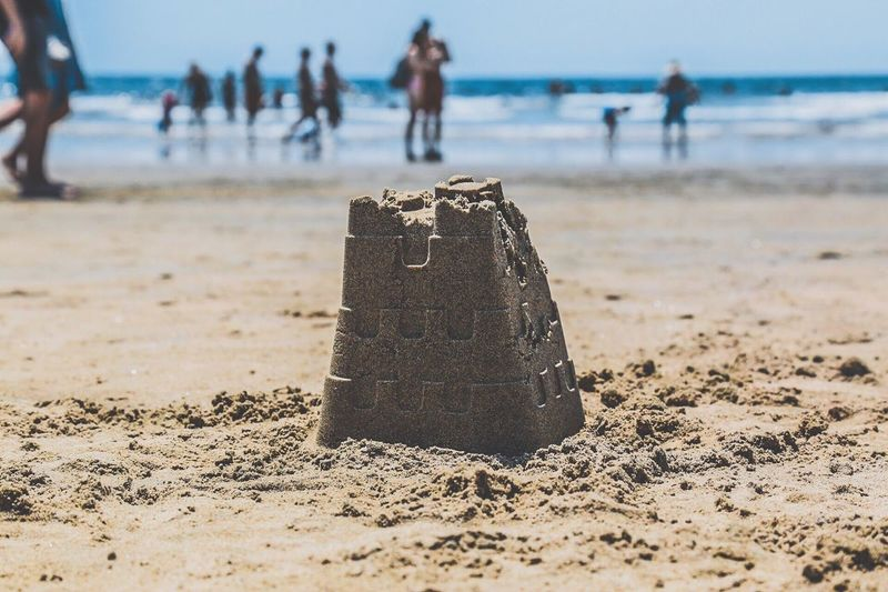 Close-up of people on beach