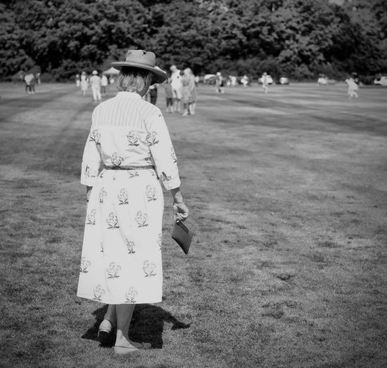 tamping in Polo Field Black And White Photography monochrome photography Tamping In Women Rear View Traditional Clothing