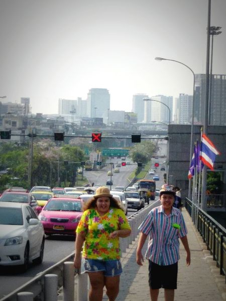 Cityscape; Capital city, walking on the Bridge, in Holidays, Afternoon in Bangkok, Nice Trafficking, View , Getting In Touch taking photos.