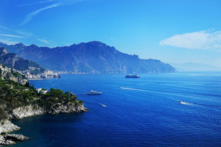 Perfect amalfitana view Amalfi Coast Cruise Ship EyeEmNewHere Travel Amalfitana Beauty In Nature Blue Day Italy Mountain Mountain Range Nature No People Outdoors Positano Sailing Scenics Sea Sky Tranquil Scene Tranquility Wake Wake - Water Water Yacht