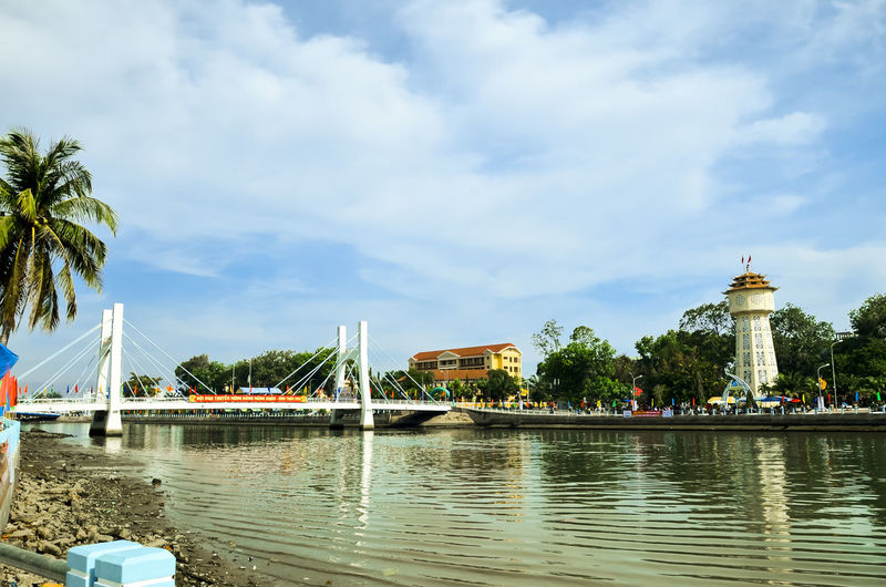 Spring boat racing in Ca Ty river Architecture Beauty In Nature Blue Boat Built Structure Ca Ty River Cloud Cloud - Sky Cloudy Day Nature No People Outdoors Phan Thiet Rippled Scenics Sky Tourism Tranquil Scene Tranquility Travel Destinations Tree Water