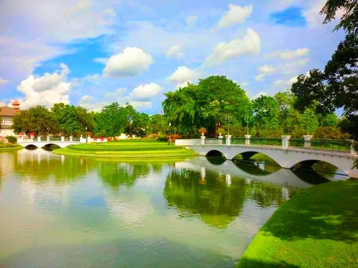 Water Reflection Tree Cloud - Sky Golf Golf Course Vacations Tourist Resort Sky Outdoors Bridge - Man Made Structure Summer Travel Destinations Palm Tree Day Green - Golf Course Beauty Sports Venue Nature No People Thailand🇹🇭 Beauty In Nature Thailand Trip Thailand Photos Thailand Love