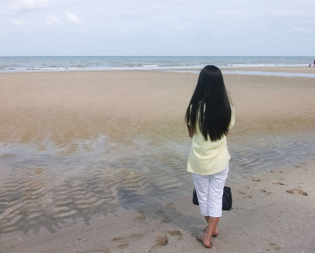 Adult Back Beach Beauty In Nature Child Day Girl Girls Horizon Over Water Human Back Nature One Person Outdoors People Rear View Sand Sea Stand For Land Standing Standing Alone Standing Water Summer Thai Thailand Water