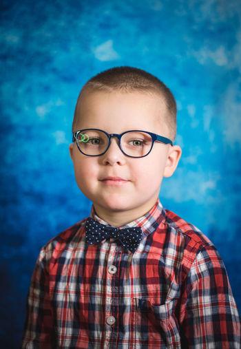 Portrait of boy wearing eyeglasses