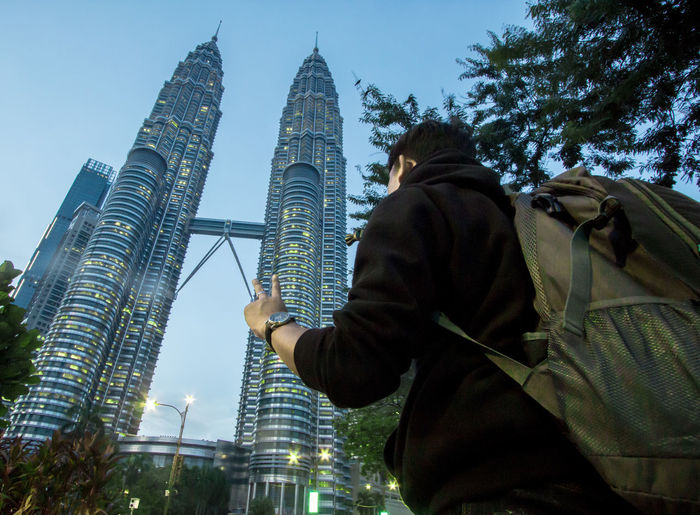 Architecture Built Structure Building Exterior Office Building Exterior City Skyscraper Tall - High Low Angle View Sky Travel Destinations Tower Building Tourism Travel Nature Real People Rear View Modern One Person Outdoors Twin Towers Pitronas Malaysia Lifestyles