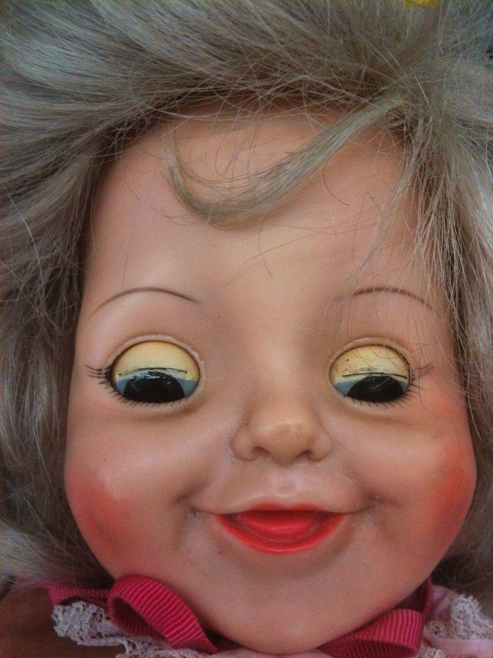 Close-Up Of Damaged Doll