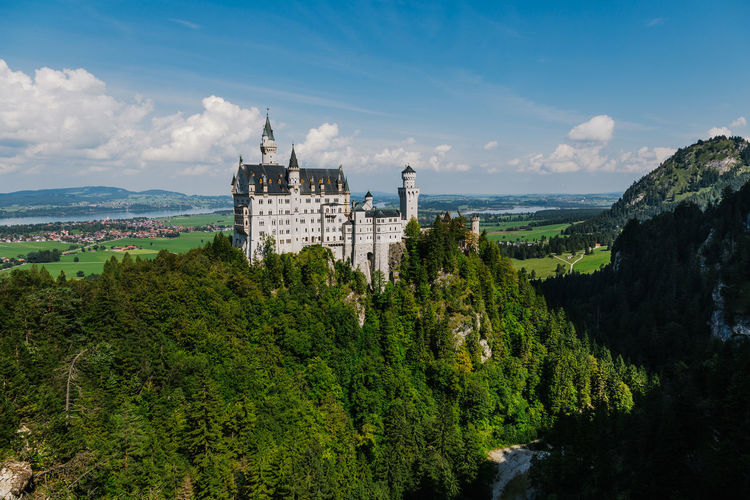 Architecture Beauty In Nature Building Exterior Built Structure Castle Cloud - Sky Day Green Color Growth History Mountain Nature Neuschwanstein No People Outdoors Plant Scenics Sky Tranquility Travel Destinations Tree Water